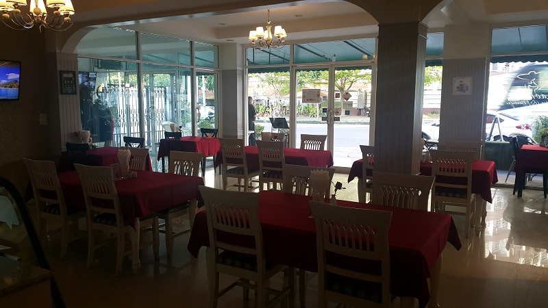 Looking out from inside Laong's Bistro. Red Tablecloths
