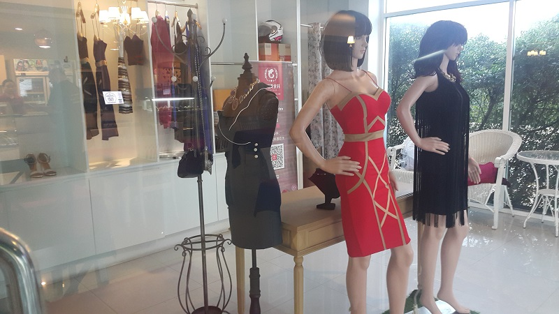 Laong's Boutique showing two Mannequeins. Will become a Cocktail Bar .