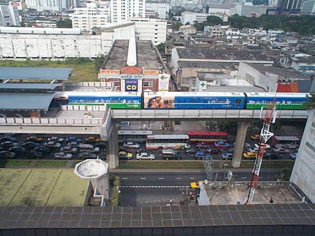 Side View of Sukhumvit Road in Bangkok with Skytrain overhead.