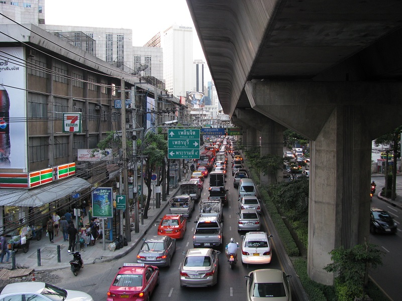 View along Sukhumvit Road of Traffic and Concrete structure overhead